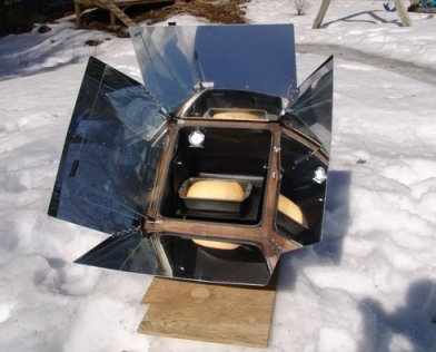 Sun oven in snow cooking food